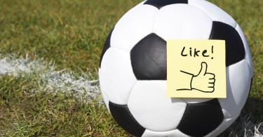 Football on pitch with sticky 'Like' note on it